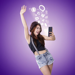 Cheerful girl enjoy entertainment on smartphone