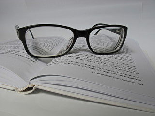 Glasses lie on a book