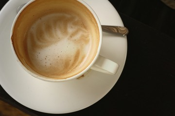 A cup of hot cappuccino coffee