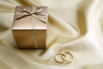 Wedding rings  on golden silk