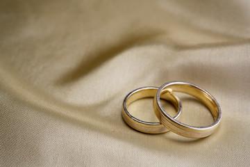 Wedding rings  on golden silk