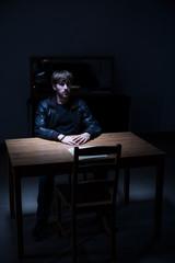 Suspect man in interrogation room