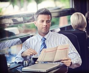 Elegant businessman traveling on luxury train