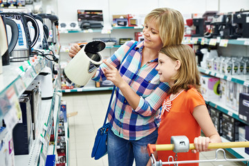Mother and daughter shopping for electric kettle