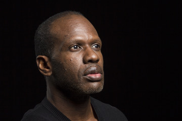 Portrait of a black male thinking, distracted, looking to the side