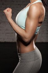 Fitness woman with spory hand, workout