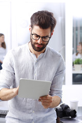 Young businessman with digital tablet