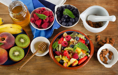 Healthy homemade fruit salad, fresh berries and fruits on   rust
