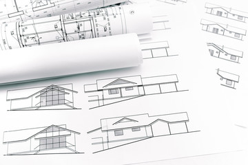 rolls of blueprints for house construction