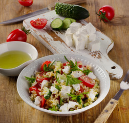 Gluten free  salad  with  feta on  wooden table.