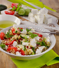 Gluten free  salad  with  feta on a wooden table.