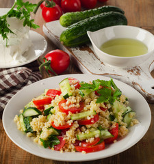 Salad with bulgur, parsley and fresh vegetables.