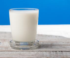 milk on wooden,blue background