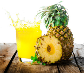 Pineapple with splash on wood