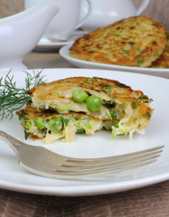 Fritters of zucchini and peas