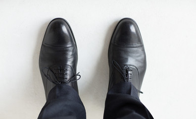 close up of man legs in elegant shoes with laces