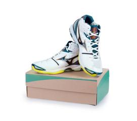 Pair of new sneakers on cardboard box