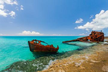 Acrylic Prints Shipwreck Ship wreckage on a beach