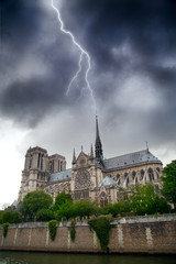 during a summer thunderstorm lightning strikes directly at Notre