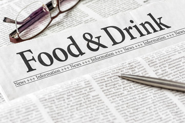A newspaper with the headline Food and Drink