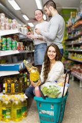 Customers choosing seed-oil at shop