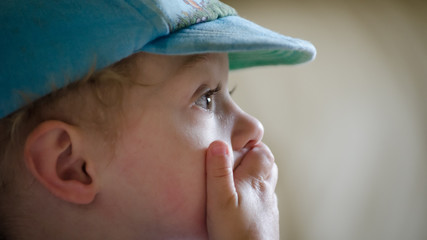 Boy covering his mouth in amazement
