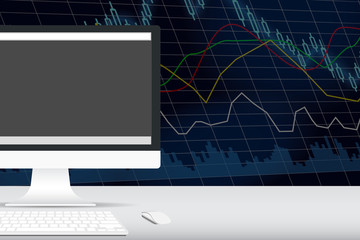 computer on the desk with stock exchange graph behind