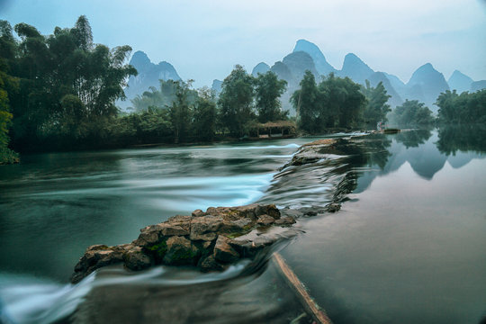 Li River at dawn with mountains in the background, Guilin, China