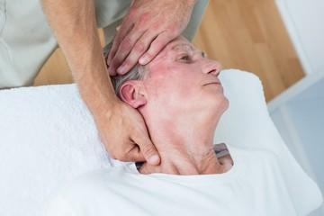Man receiving neck massage