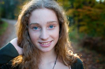 teen girl outdoors in fall
