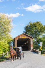 Amish Horse and Buggy Riding Under the Covered Bridge
