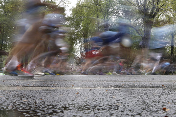 Running in the rain blurred motion few people