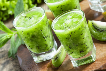 Fresh green smoothie with kiwi, cucumber, selective focus