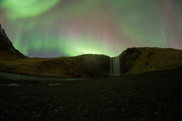 Aurora over Skogafoss Waterfall Iceland