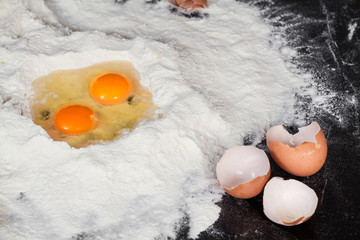 two eggs in flour