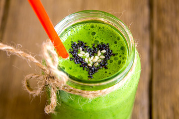 Green smoothie with heart of seeds Wall mural