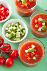 cold gazpacho soup in glass and ingredients