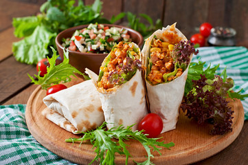 Burritos wraps with minced beef and vegetables