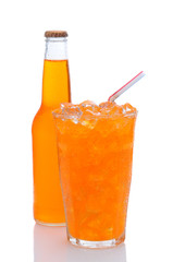Glass of Orange Soda With Drinking Straw and Bottle