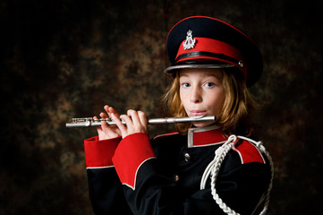 girl in a marching band uniform with a flute