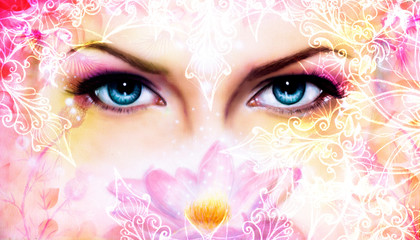blue women eyes beaming up enchanting from behind a blooming