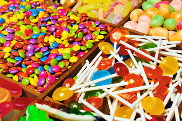 assortment of candy for a background, in a printers box.