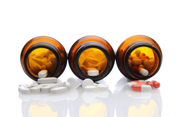 Medicine Bottles with Pills Spilling Out