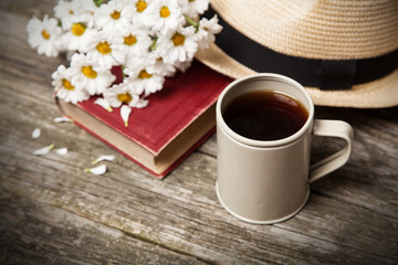 Coffee, daisies and a book