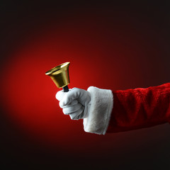Santa Claus Ringing a Bell Over a Light to Dark Red Background