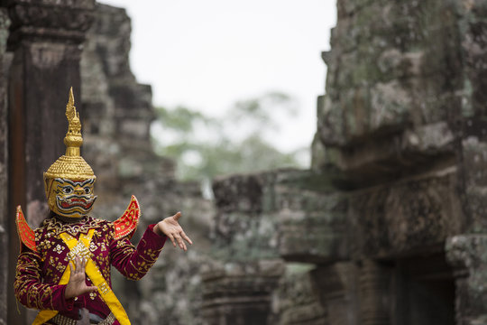 Hindu deity with hands gestures reenacted by an actor in colorfu
