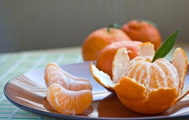 Tangerine on brown plate