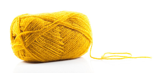 Yellow wool yarn isolated on white background