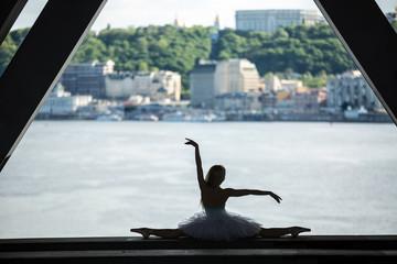 Cropped picture legs of graceful ballerina in white tutu