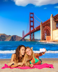 happy girl friends selfie portrait beach sand